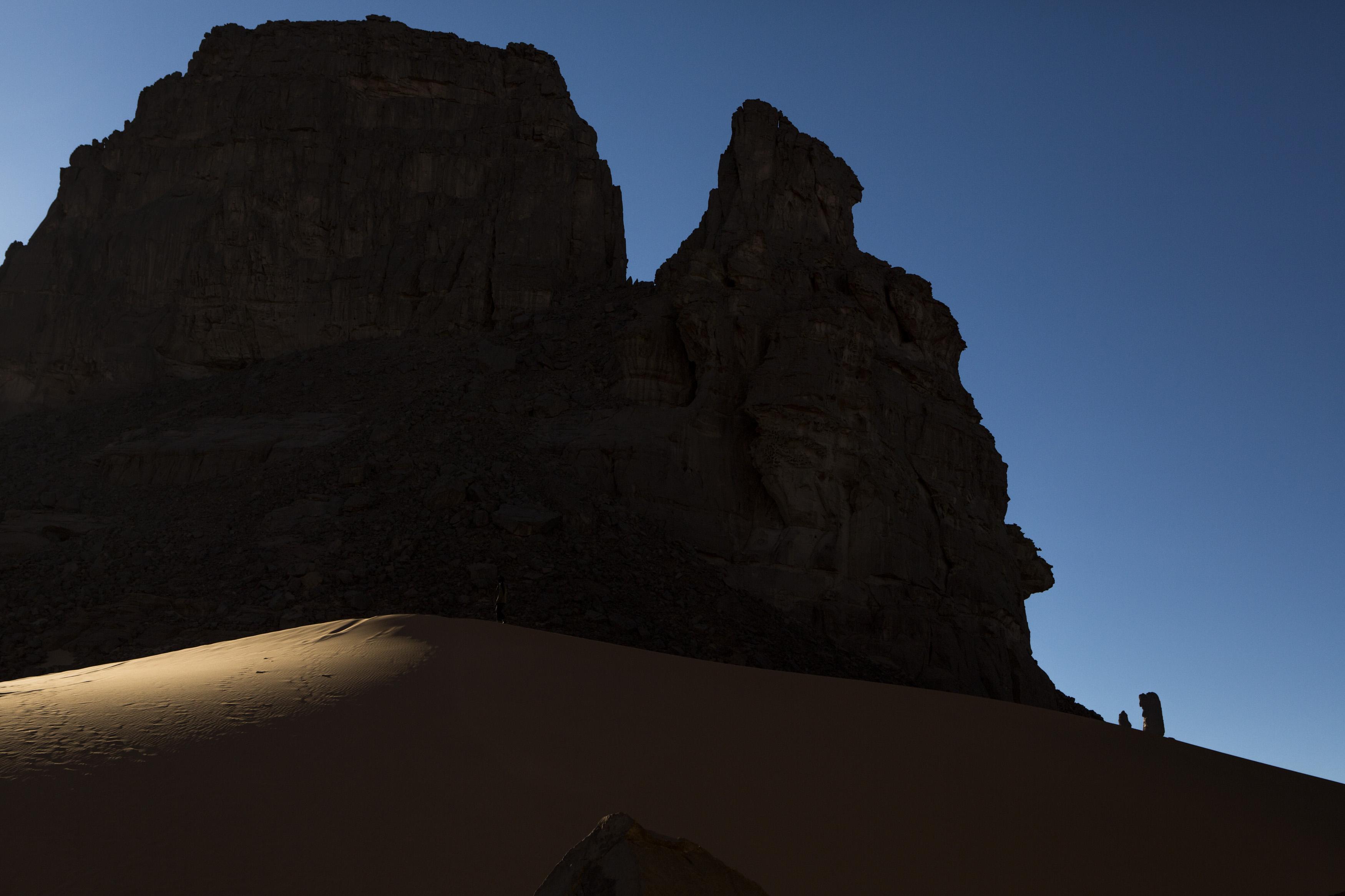 Landscape of the Tadrart. The Tadrart (200 km southeast of Djanet) is located in the south of the Tassili N'Ajjer National Park and is part of one of the most beautiful desert in the world but above all the central Sahara. From huge canyons to cliffs carved with rocky peaks of various shapes mix with dunes of colored sand with yellow and red reflections. The Tadrart, Algeria-February 6, 2017.  Paysage de la Tadrart. La Tadrart (200 km au sud-est de Djanet) se situe dans le sud du Parc National du Tassili N'Ajjer et il fait partie d'un des plus beau désert au monde mais avant tout du Sahara central.  D'immenses canyons aux falaises sculptées avec de pitons rocheux aux formes les plus diverses  se mélangent avec des dunes de sable coloré aux reflets jaune et rouge. La Tadrart,, Algérie-6 février 2017.