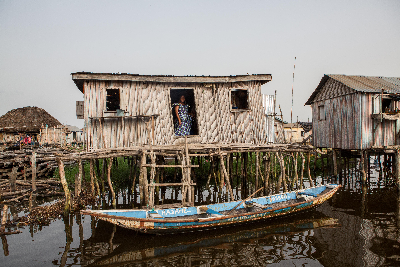 Ganvié. A man on his canoe on Lake Nokoué. Ganvié is a lakeside city in southern Benin that is part of the municipality of Sô-Ava in the Atlantic department, located on Lake Nokoué north of the metropolis of Cotonou, it is listed since 1996 on the indicative list ofUNESCO but it is not yet classified. Ganvié is one of the six projects included in the 2016-2021 Government Action Program (GAP) to develop tourism. The cost of the project is estimated at 20 billion CFA francs (about 30.5 million euros).It includes sanitation and cleaning of the lake (from mid-2018 to the end of 2019. Ganvié 1, Benin - March 28, 2018. Vie sur l'eau à Ganvié.  Un homme sur sa pirogue sur le lac Nokoué. Ganviéest unecité lacustredu sud duBénin qui fait partie de lacommunedeSô-Avadans ledépartement de l'Atlantique, situé sur lelac Nokouéau nord de la métropole deCotonou, elle est inscrite depuis 1996 sur la liste indicative de l'UNESCO mais elle n'est pas encore classée. Ganvié fait partie des six projets retenus dans le Programme d'actions du gouvernement (PAG) 2016-2021 pourdévelopper le tourisme. Le coût du projet est estimé à 20milliards de FCFA (près de 30,5millions d'euros). Il comprend l'assainissement et le curage du lac (de la mi-2018 à la fin de 2019. Ganvié 1, Bénin- 28 mars 2018., 2018.